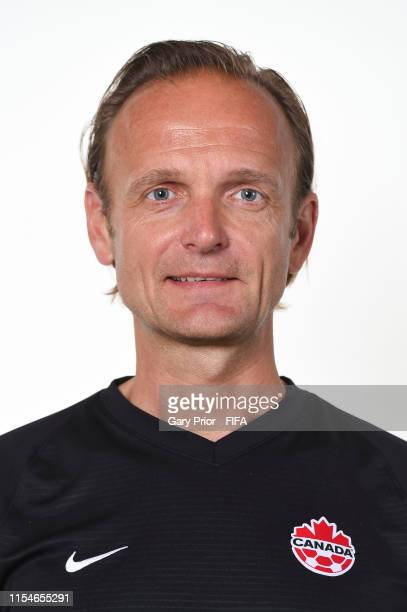 Kenneth Heiner-Moller, Head Coach of Canada poses for a portrait during the official FIFA Women's World Cup 2019 portrait session at Courtyard by...