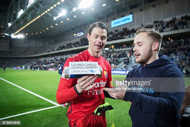 Kenneth Hoie of Djurgardens IF is being given Snus swedish tobacco after the Allsvenskan match between Djurgardens IF and BK Hacken at Tele2 Arena on...