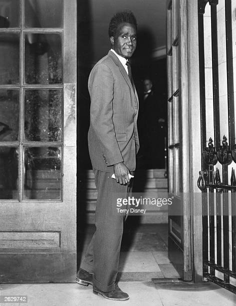 Kenneth Kaunda leader of the Northern Rhodesian African Nationalists arriving at the Colonial Office for talks with the British Government about his...