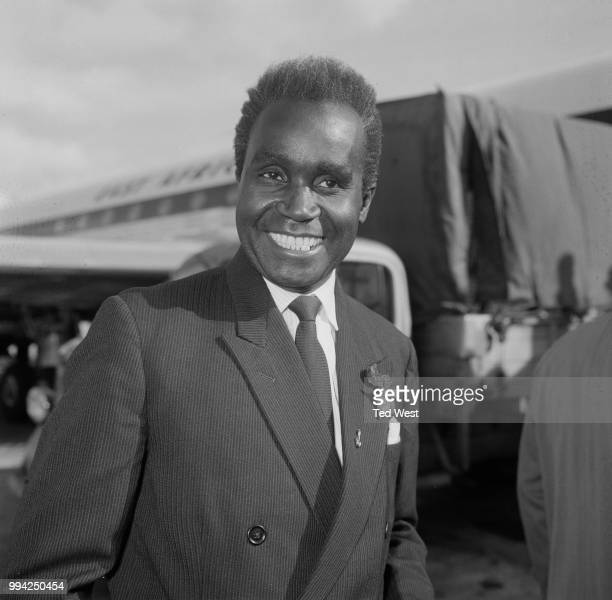Kenneth Kaunda the Prime Minister of Northern Rhodesia arrives at London Airport for talks at Marlborough House 1st May 1964 The topic of discussion...