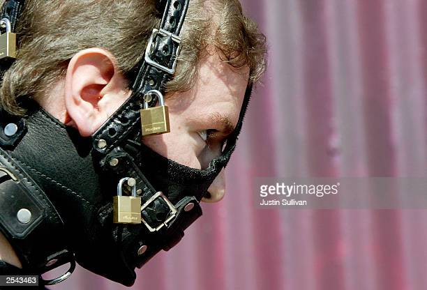 Kenneth Lareau of Tracy California wears his bondage mask at the 20th Annual Folsom Street Fair September 28 2003 in San Francisco California The...