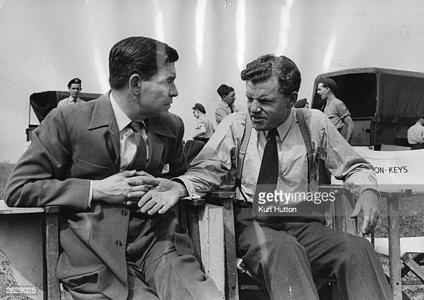 Kenneth More on the set of his new film 'Reach For The Sky' which is about the Battle of Britain and the exploits of the air pilot Douglas Bader who...