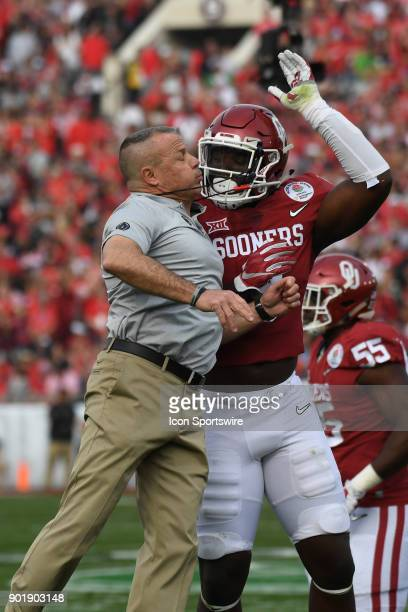Kenneth Murray of the Oklahoma Sooners celebrates with Director of Sports Enhancement Jerry Schmidt during the College Football Playoff Semifinal at...