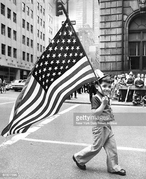 Kenneth Nieves of Manhattan carries a flag during the Puerto Rican Day Parade