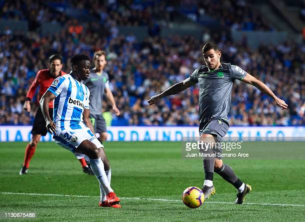 Kenneth Omeruo of CD Leganes duels for the ball with Theo Hernandez of Real Sociedad during the La Liga match between Real Sociedad and CD Leganes at...