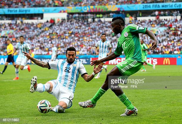Kenneth Omeruo of Nigeria and Ezequiel Lavezzi of Argentina compete for the ball during the 2014 FIFA World Cup Brazil Group F match between Nigeria...