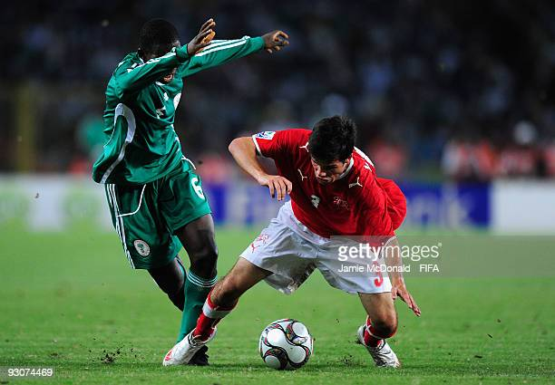 Kenneth Omeruo of Nigeria battles with Janick Kamber of Switzerland during the FIFA U17 World Cup Final match between Switzerland and Nigeria at the...