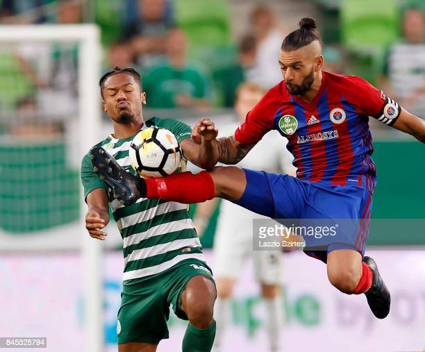 Kenneth Otigba of Ferencvarosi TC fights for the ball with Mohamed Remili of Vasas FC during the Hungarian OTP Bank Liga match between Ferencvarosi...