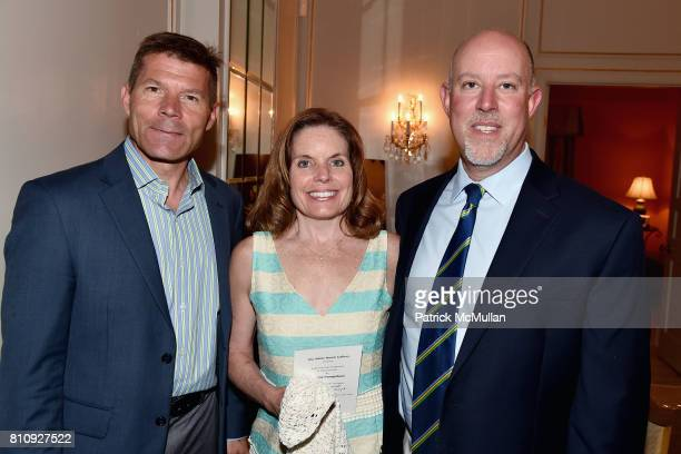 Kenneth Poliwoda Lorrie Saporita and Mark Saporita attend Katrina and Don Peebles Host NY Mission Society Summer Cocktails at Private Residence on...