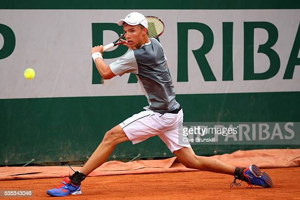 Kenneth Raisma of Estonia hits a forehand during the Boys Singles first round match against Yshai Oliel of Israel on day eight of the 2016 French...