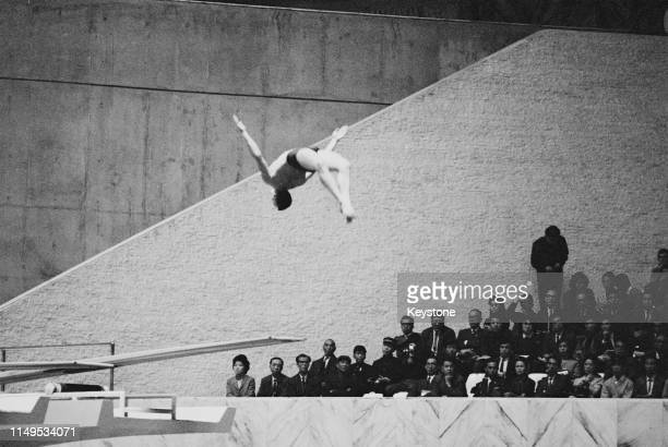 Kenneth Sitzberger of the United States competes in the Men's 3 metre springboard diving competition on 13th October 1964 during the XVIII Summer...