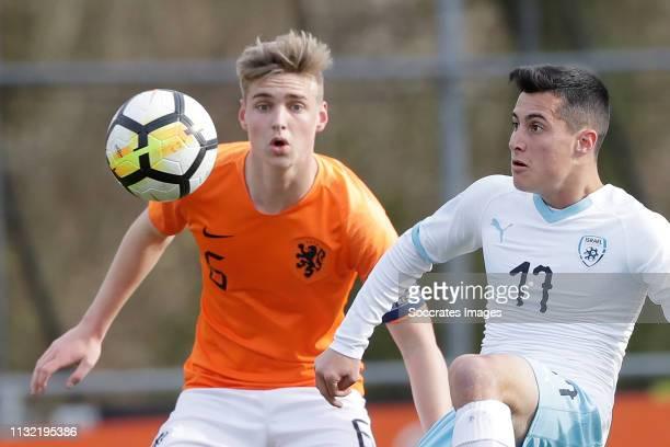 Kenneth Taylor of Holland U17 Niv Berkovitz of Israel U17 during the match between Holland U17 v Israel U17 at the Sportpark Zegersloot on March 23...