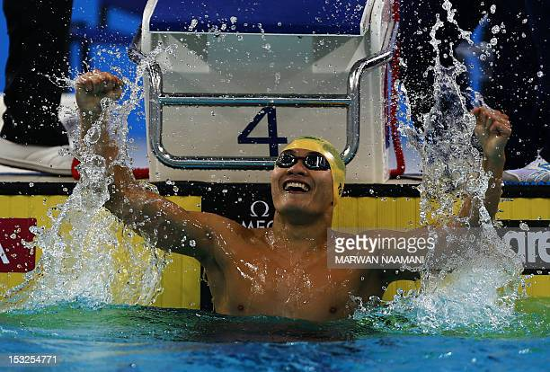 Kenneth To of Australia celebrates after winning the men's 100m individual medley final in the FINA/ARENA Swimming World Cup 2012 in Dubai on October...