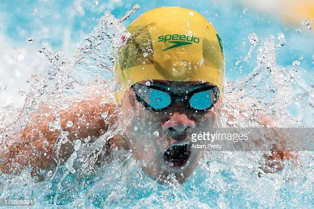 Kenneth To of Australia competes during the Swimming Men's 4x100m Medley Relay preliminaries heat one on day sixteen of the 15th FINA World...