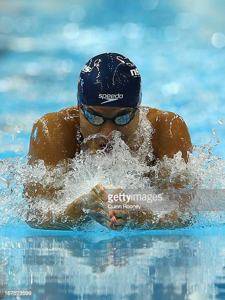 Kenneth To of Australia competes in the Men's 100 Metre Breaststroke Semi Final during day one of the Australian Swimming Championships at the SA...