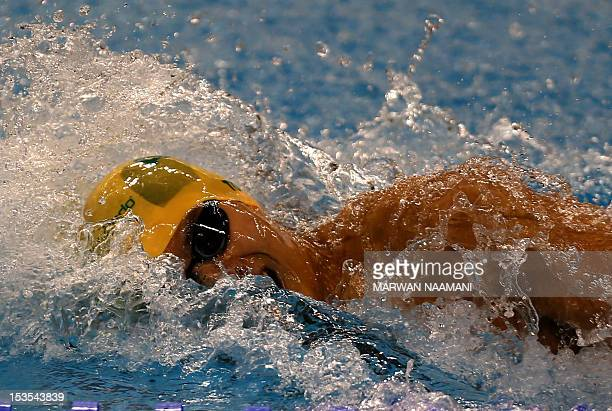 Kenneth To of Australia competes in the Men's 100m individual medley final during the FINA/ARENA Swimming World Cup 2012 in Doha on October 6 2012...