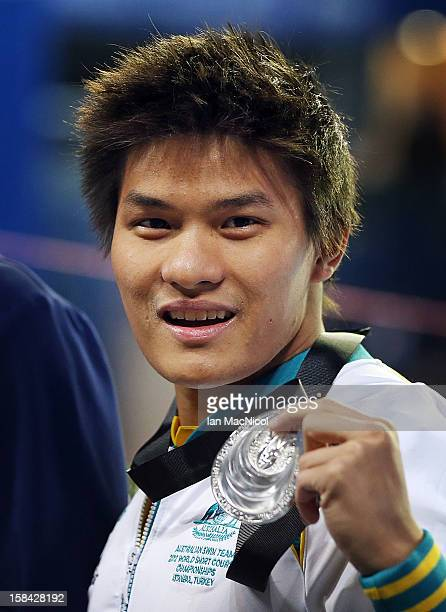 Kenneth To of Australia poses with his silver medal from the Men's 10m individual medley during day five of the 11th FINA Short Course World...
