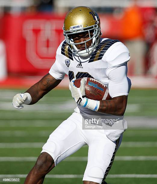 Kenneth Walker III of the UCLA Bruins runs the ball against the Utah Utes during the first half of a college football game at Rice Eccles Stadium on...