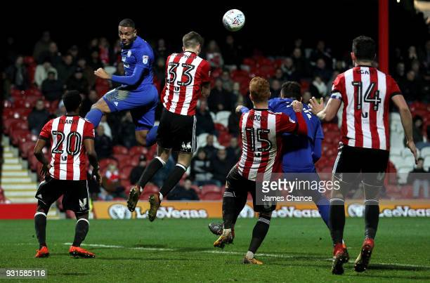 Kenneth Zohore of Cardiff City attempts to win a header over Chris Mepham of Brentford during the Sky Bet Championship match between Brentford and...