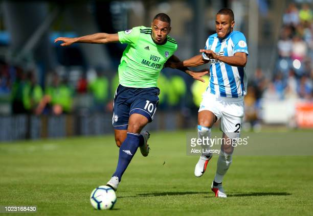Kenneth Zohore of Cardiff City battles for posession with Mathias Zanka Jorgensen of Huddersfield Town during the Premier League match between...