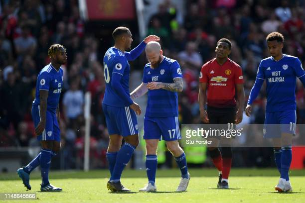 Kenneth Zohore of Cardiff City embraces Aron Gunnarsson of Cardiff City as he is substituted during the Premier League match between Manchester...