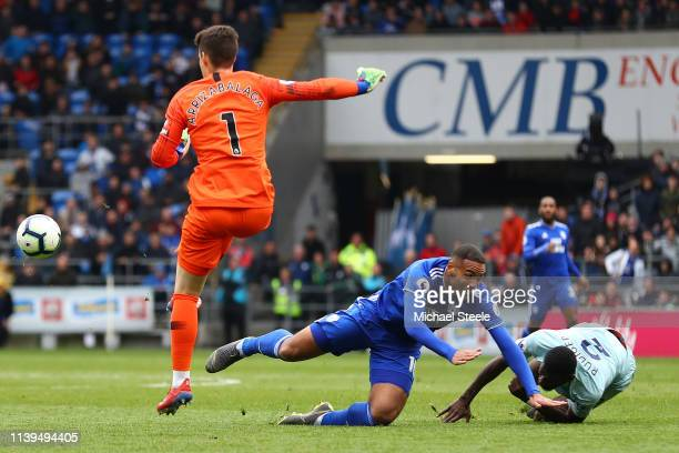 Kenneth Zohore of Cardiff City is challenged by Antonio Ruediger of Chelsea which leads to Antonio Ruediger of Chelsea being shown the yellow card...