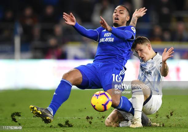Kenneth Zohore of Cardiff City is challenged by Lucas Digne of Everton during the Premier League match between Cardiff City and Everton FC at Cardiff...