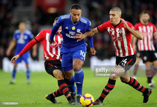 Kenneth Zohore of Cardiff City is challenged by Mohamed Elyounoussi of Southampton and Oriol Romeu of Southampton during the Premier League match...