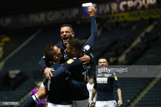 Kenneth Zohore of Millwall celebrates with his team mates after scoring his sides first goal during the Sky Bet Championship match between Preston...