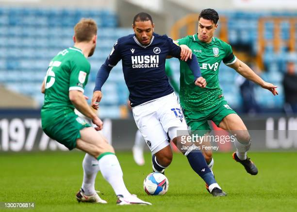 Kenneth Zohore of Millwall FC put under pressure by Tom Lees of Sheffield Wednesday and Joey Pelupessy of Sheffield Wednesday during the Sky Bet...
