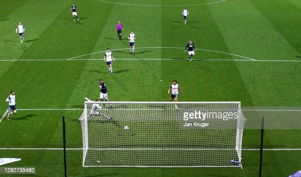 Kenneth Zohore of Millwall scores his sides first goal past Declan Rudd of Preston North End during the Sky Bet Championship match between Preston...