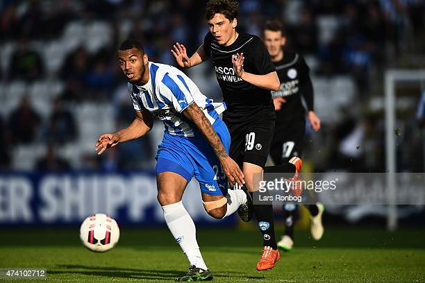 Kenneth Zohore of OB Odense and Robert Skov of Silkeborg IF compete for the ball during the Danish Alka Superliga match between OB Odense and...
