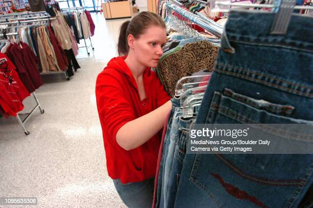 Kenni Anderson sorts and tags clothes during setup for the Goodwill Store in Lafayette on Thursday December 2 2010