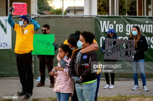 Kennia Viera, of Los Angeles, center, who is a single mom, unemployed and in danger of being evicted at the end of January, hugs her kids,...