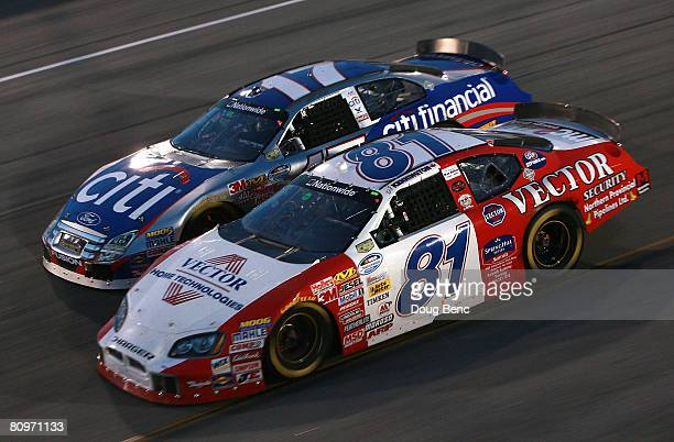 J Kennington driver of the Vector Security Dodge races side by side with Matt Kenseth driver of the CitiFinancial Ford during the NASCAR Nationwide...