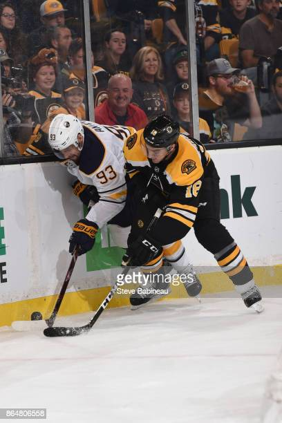 Kenny Agostino of the Boston Bruins fights for the puck against Victor Antipin of the Buffalo Sabres at the TD Garden on October 21 2017 in Boston...