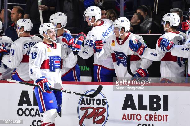 Kenny Agostino of the Laval Rocket celebrates his third period goal with teammates on the bench against the Binghamton Devils during the AHL game at...