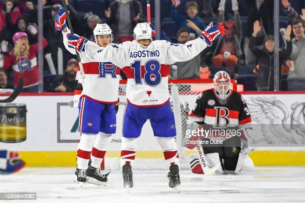 Kenny Agostino of the Laval Rocket congradulates Jake Evans of the Laval Rocket for his goal on Filip Gustavsson of the Belleville Senators at Place...