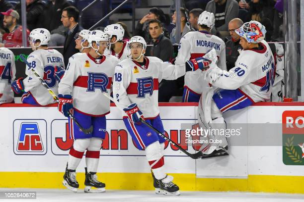 Kenny Agostino of the Laval Rocket gives a highfive to Michael McNiven of the Laval Rocket after scoring his second goal of the game against the...