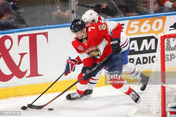Kenny Agostino of the Montreal Canadiens defends against Colton Sceviour of the Florida Panthers during third period action at the BBT Center on...