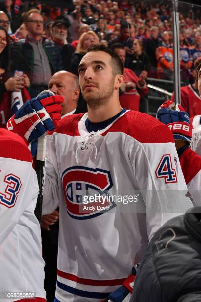 Kenny Agostino of the Montreal Canadiens stands for the singing of the national anthem prior to the game against the Edmonton Oilers on November 13...