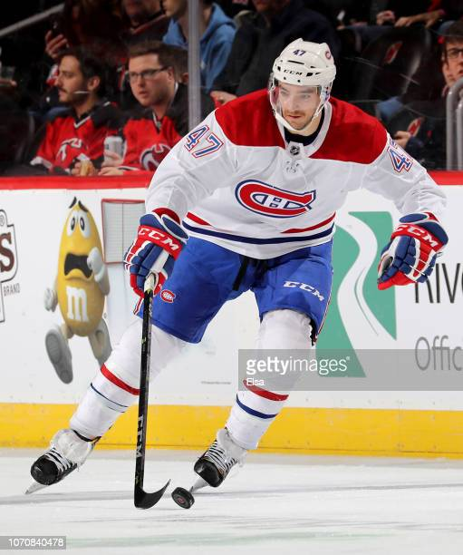 Kenny Agostino of the Montreal Canadiens takes the puck in the first period against the New Jersey Devils at Prudential Center on November 21 2018 in...