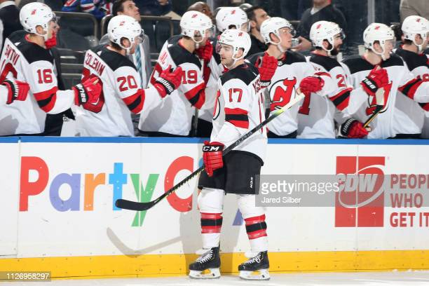 Kenny Agostino of the New Jersey Devils celebrates after scoring a goal in the third period against the New York Rangers at Madison Square Garden on...