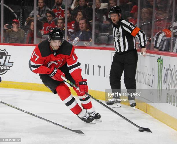 Kenny Agostino of the New Jersey Devils skates against the Buffalo Sabres at the Prudential Center on February 17 2019 in Newark New Jersey The...