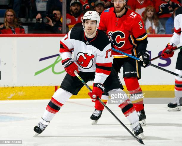 Kenny Agostino of the New Jersey Devils skates against the Calgary Flames during an NHL game on March 12 2019 at the Scotiabank Saddledome in Calgary...