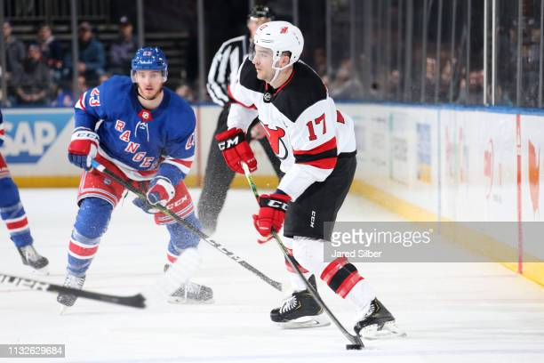 Kenny Agostino of the New Jersey Devils skates with the puck against the New York Rangers at Madison Square Garden on February 23 2019 in New York...