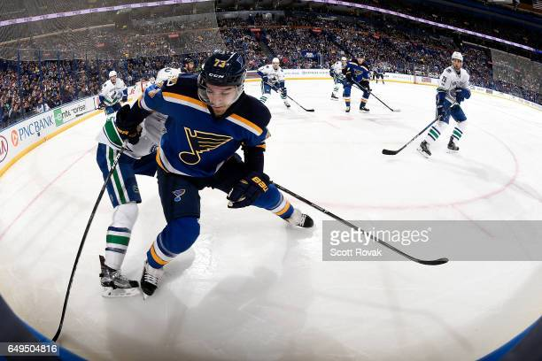 Kenny Agostino of the St Louis Blues handles the puck against the Vancouver Canucks on February 16 2017 in St Louis Missouri