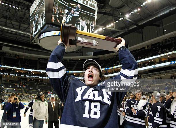 Kenny Agostino of the Yale Bulldogs celebrates after defeating the Quinnipiac Bobcats in the Men's Ice Hockey National Championship game at Consol...