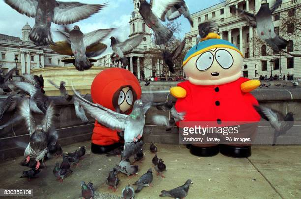 Kenny and Cartman characters from the South Park cartoon television show feed the pigeons in Trafalgar Square during their tour around London to...