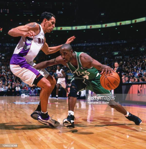 Kenny Anderson of the Boston Celtics handles the ball against Doug Christie of the Toronto Raptors on November 2 1999 at the Air Canada Centre in...